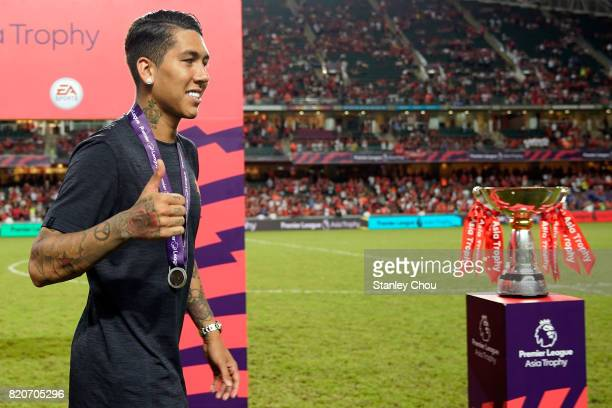 Roberto Firmino of Liverpool celebrates after beating Leicester City 21 in the final during the Premier League Asia Trophy match between Liverpool FC...