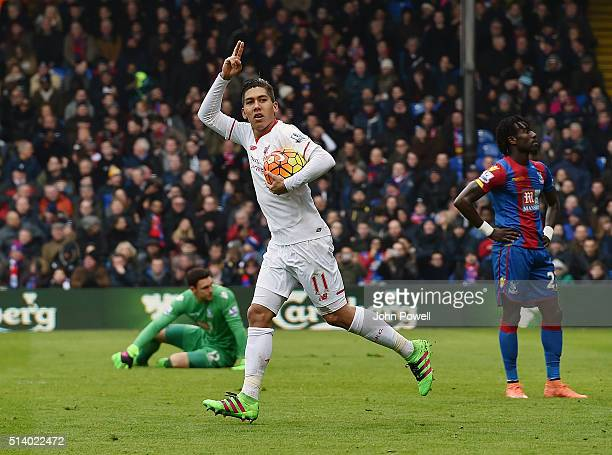 Roberto Firmino of Liverpool celebrates after scoing the equalising goal during the Barclays Premier League match between Crystal Palace and...