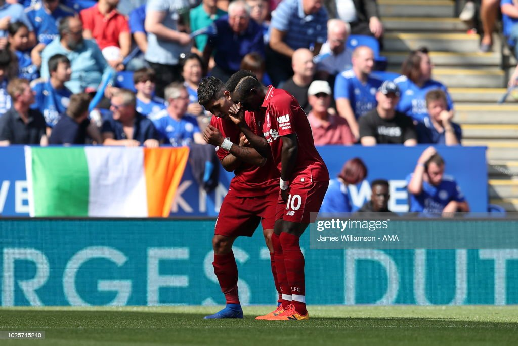 Roberto Firmino of Liverpool celebrates after scoring a goal to make it 2-0 during the Premier League match between Leicester City and Liverpool FC at The King Power Stadium on September 1, 2018 in Leicester, United Kingdom.
