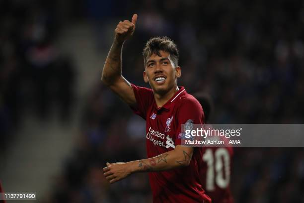 Roberto Firmino of Liverpool celebrates after scoring a goal to make it 1-3 during the UEFA Champions League Quarter Final second leg match between...