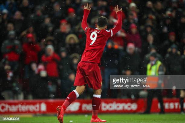 Roberto Firmino of Liverpool celebrates after scoring a goal to make it 30 during the Premier League match between Liverpool and Watford at Anfield...