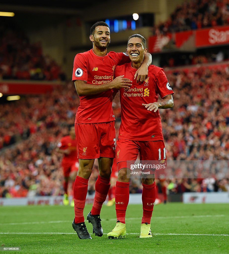 Roberto Firmino of Liverpool celebrates after scoring during the Premier League match between Liverpool and Leicester City at Anfield on September 10, 2016 in Liverpool, England.