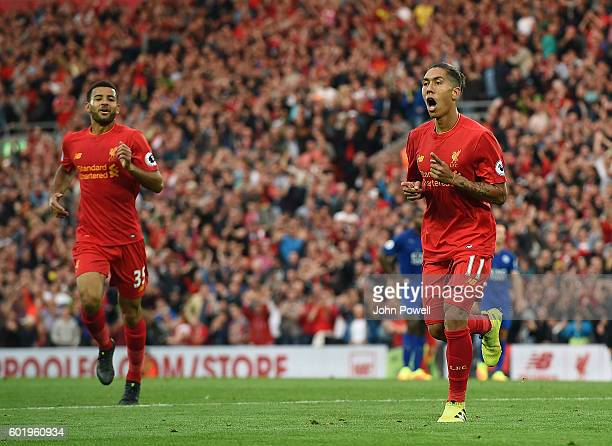 Roberto Firmino of Liverpool celebrates after scoring during the Premier League match between Liverpool and Leicester City at Anfield on September 10...
