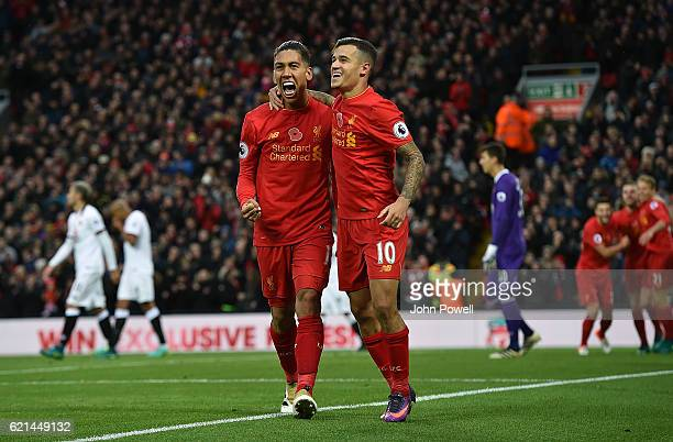 Roberto Firmino of Liverpool celebrates after scoring during the Premier League match between Liverpool and Watford at Anfield on November 6 2016 in...