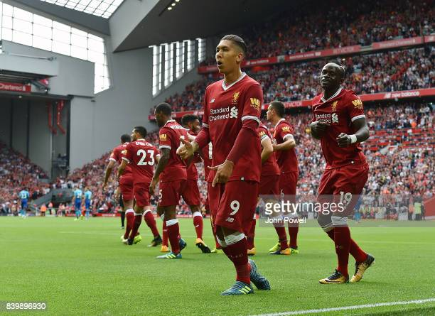 Roberto Firmino of Liverpool celebrates after scoring during the Premier League match between Liverpool and Arsenal at Anfield on August 27 2017 in...