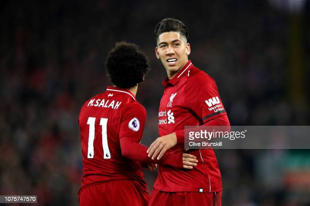 Roberto Firmino of Liverpool celebrates after scoring his sides first goal during the Premier League match between Liverpool FC and Arsenal FC at...