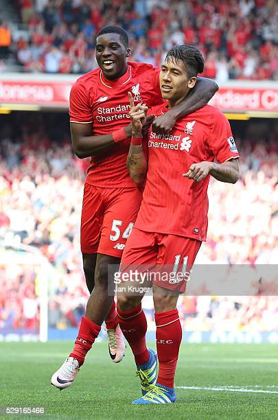 Roberto Firmino of Liverpool celebrates after scoring his side's second goal with Sheyi Ojo of Liverpool during the Barclays Premier League match...