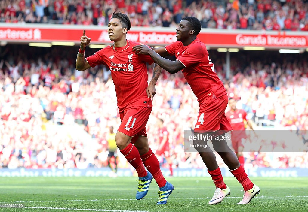 Roberto Firmino of Liverpool (L) celebrates after scoring his side's second goal with Sheyi Ojo of Liverpool during the Barclays Premier League match between Liverpool and Watford at Anfield on May 8, 2016 in Liverpool, England.