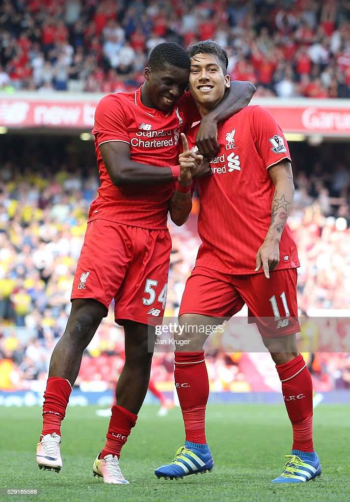 Roberto Firmino of Liverpool (R) celebrates after scoring his side's second goal with Sheyi Ojo of Liverpool during the Barclays Premier League match between Liverpool and Watford at Anfield on May 8, 2016 in Liverpool, England.