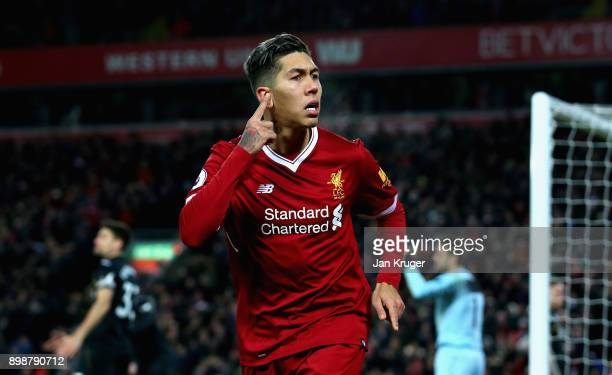 Roberto Firmino of Liverpool celebrates after scoring his sides second goal during the Premier League match between Liverpool and Swansea City at...