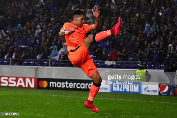 Roberto Firmino of Liverpool celebrates after scoring his sides fourth goal during the UEFA Champions League Round of 16 First Leg match between FC...
