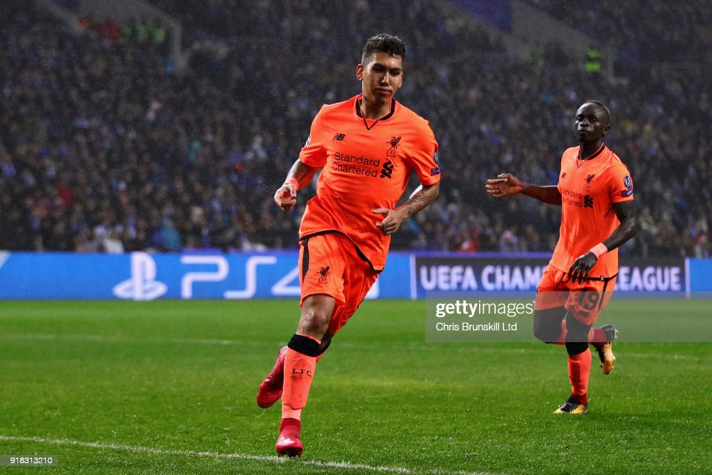 Roberto Firmino of Liverpool celebrates after scoring his sides fourth goal during the UEFA Champions League Round of 16 First Leg match between FC Porto and Liverpool at Estadio do Dragao on February 14, 2018 in Porto, Portugal.
