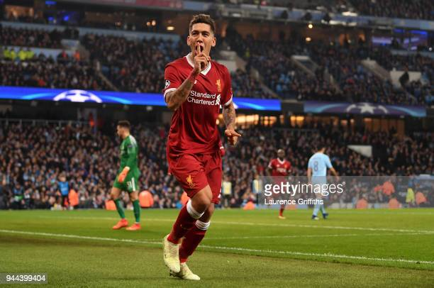 Roberto Firmino of Liverpool celebrates after scoring his sides second goal during the UEFA Champions League Quarter Final Second Leg match between...