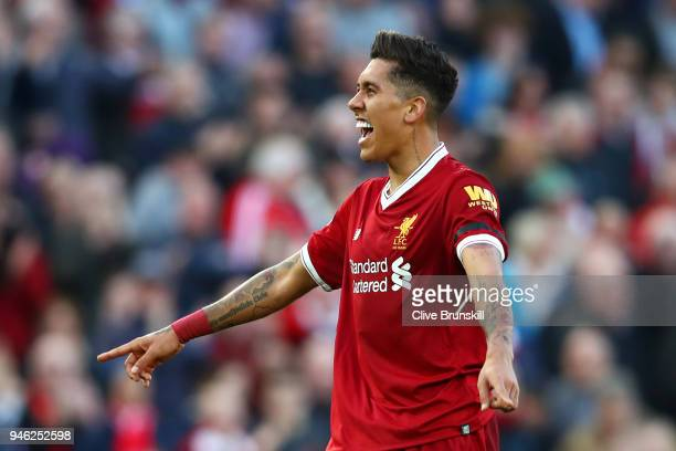 Roberto Firmino of Liverpool celebrates after scoring his sides third goal during the Premier League match between Liverpool and AFC Bournemouth at...