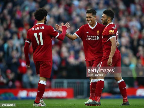 Roberto Firmino of Liverpool celebrates after scoring his sides third goal with Mohamed Salah ofLiverpool and Alex OxladeChamberlain of Liverpool...