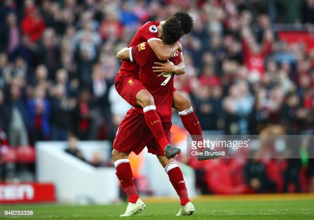 Roberto Firmino of Liverpool celebrates after scoring his sides third goal Alex OxladeChamberlain of Liverpool during the Premier League match...
