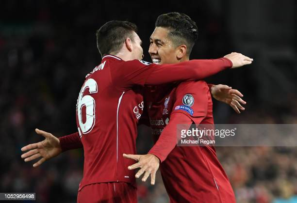 Roberto Firmino of Liverpool celebrates after scoring his team's first goal with Andy Robertson of Liverpool during the Group C match of the UEFA...