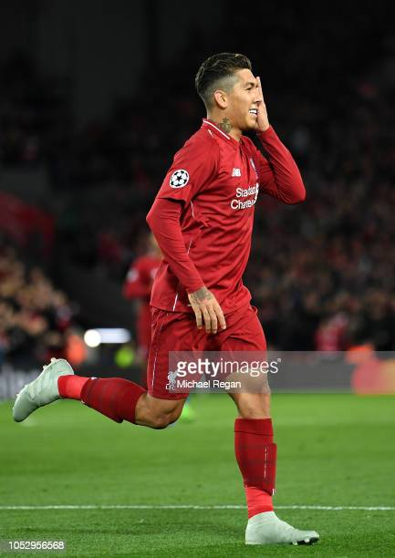 Roberto Firmino of Liverpool celebrates after scoring his team's first goal during the Group C match of the UEFA Champions League between Liverpool...