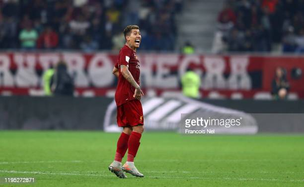 Roberto Firmino of Liverpool celebrates after scoring his team's first goal during the FIFA Club World Cup Qatar 2019 Final between Liverpool FC and...