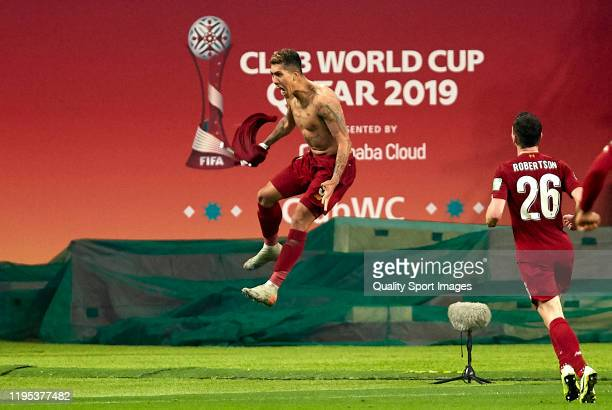 Roberto Firmino of Liverpool celebrates after scoring his team's first goal during the FIFA Club World Cup Qatar 2019 Final match between Liverpool...