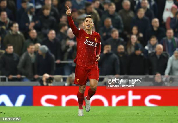 Roberto Firmino of Liverpool celebrates after scoring his team's first goal during the Premier League match between Tottenham Hotspur and Liverpool...