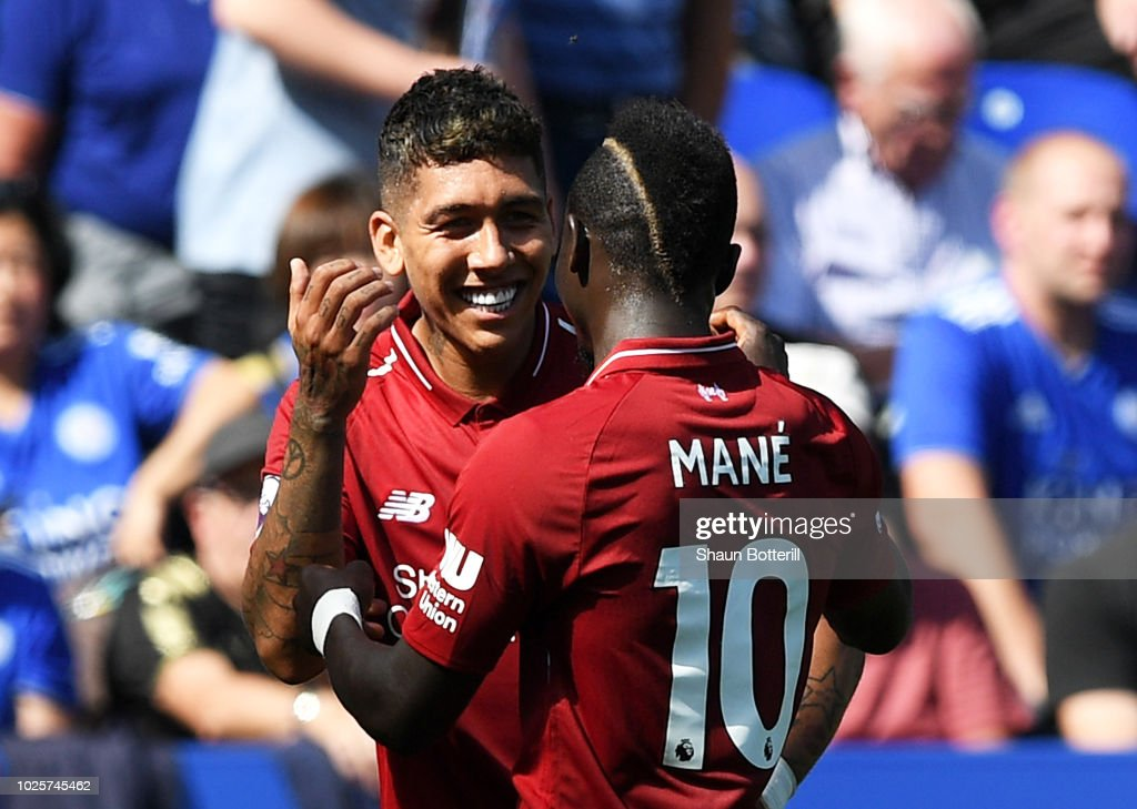 Roberto Firmino of Liverpool celebrates after scoring his team's second goal with Sadio Mane during the Premier League match between Leicester City and Liverpool FC at The King Power Stadium on September 1, 2018 in Leicester, United Kingdom.