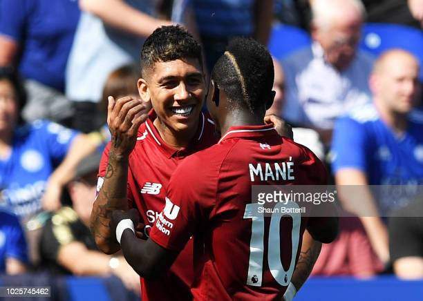 Roberto Firmino of Liverpool celebrates after scoring his team's second goal with Sadio Mane during the Premier League match between Leicester City...
