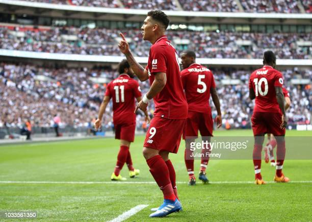 Roberto Firmino of Liverpool celebrates after scoring his team's second goal during the Premier League match between Tottenham Hotspur and Liverpool...