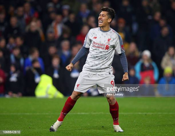 Roberto Firmino of Liverpool celebrates after scoring his team's second goal during the Premier League match between Burnley FC and Liverpool FC at...