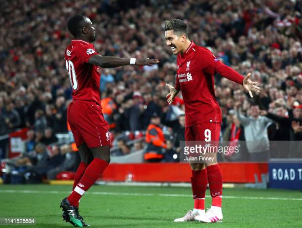 Roberto Firmino of Liverpool celebrates after scoring his team's second goal with Sadio Mane of Liverpool during the UEFA Champions League Quarter...