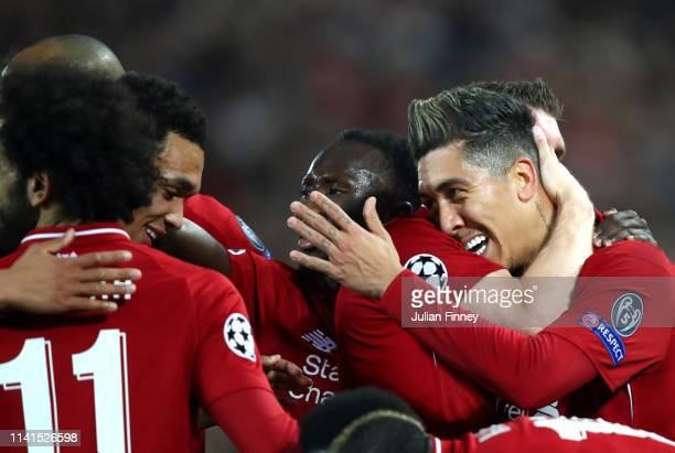 Roberto Firmino of Liverpool celebrates after scoring his team's second goal with his team mates during the UEFA Champions League Quarter Final first...