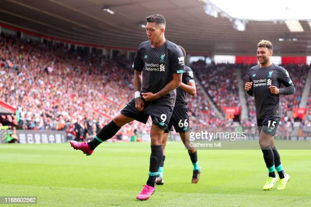 Roberto Firmino of Liverpool celebrates after scoring his team's second goal during the Premier League match between Southampton FC and Liverpool FC...
