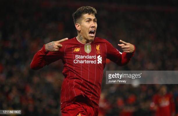 Roberto Firmino of Liverpool celebrates after scoring his team's second goal during the UEFA Champions League round of 16 second leg match between...