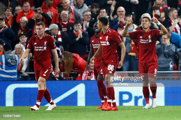 Roberto Firmino of Liverpool celebrates after scoring his team's third goal during the Group C match of the UEFA Champions League between Liverpool...