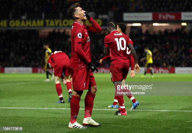 Roberto Firmino of Liverpool celebrates after scoring his team's third goal during the Premier League match between Watford FC and Liverpool FC at...
