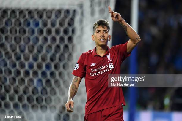 Roberto Firmino of Liverpool celebrates after scoring his team's third goal during the UEFA Champions League Quarter Final second leg match between...
