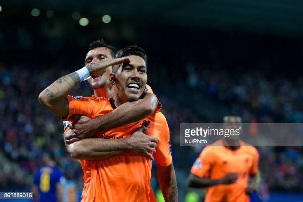 Roberto Firmino of Liverpool celebrates after scoring the fifth goal of Liverpool FC during the UEFA Champions League match between NK Maribor and...