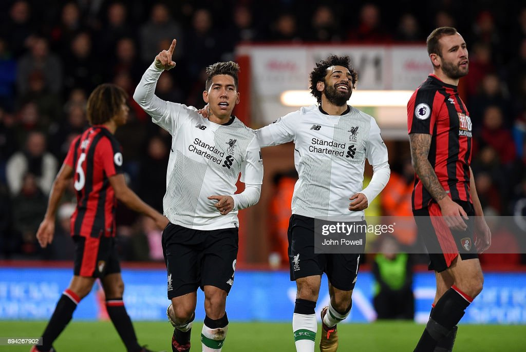Roberto Firmino of Liverpool celebrates after scoring the fourth goal during the Premier League match between AFC Bournemouth and Liverpool at Vitality Stadium on December 17, 2017 in Bournemouth, England.