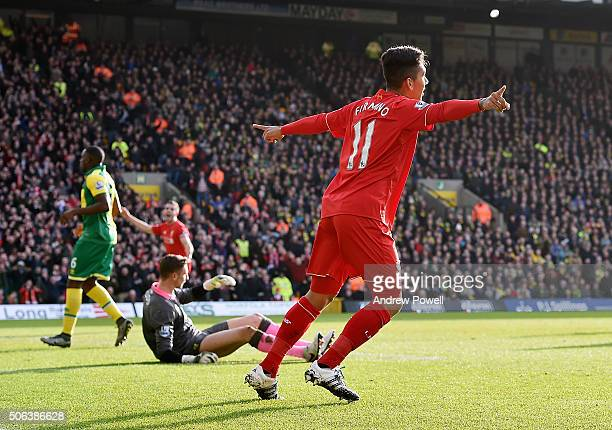 Roberto Firmino of Liverpool celebrates after scoring the opening goal during the Barclays Premier League match between Norwich City and Liverpool at...