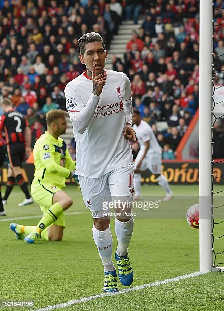 Roberto Firmino of Liverpool celebrates after scoring the opening goal during the Barclays Premier League match between A.F.C. Bournemouth and...
