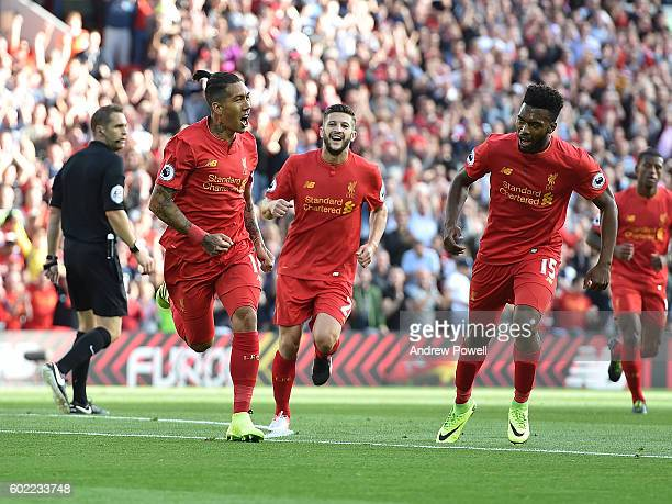 Roberto Firmino of Liverpool celebrates after scoring the opening goal during the Premier League match between Liverpool and Leicester City at...