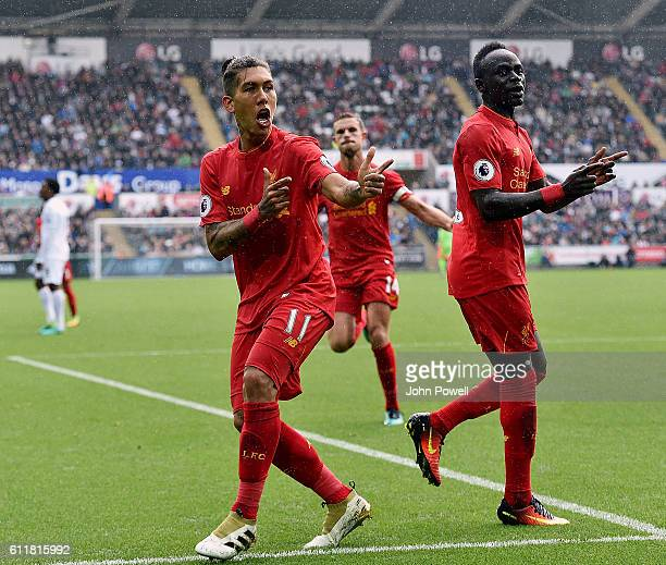 Roberto Firmino of Liverpool celebrates after scoring the opening goal during the Premier League match between Swansea City and Liverpool at Liberty...