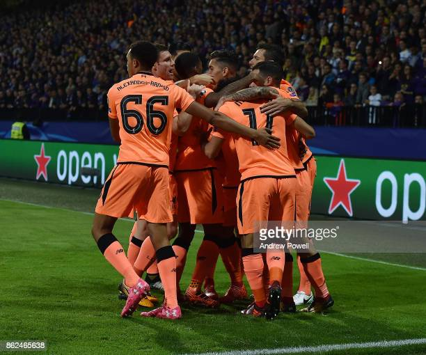 Roberto Firmino of Liverpool celebrates after scoring the opening goal during the UEFA Champions League group E match between NK Maribor and...
