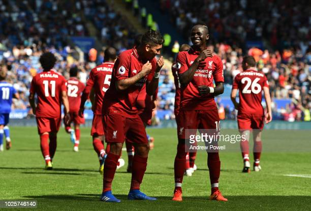 Roberto Firmino of Liverpool celebrates after scoring the second goal during the Premier League match between Leicester City and Liverpool FC at The...