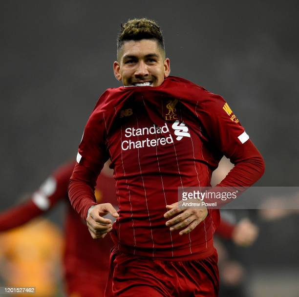 Roberto Firmino of Liverpool celebrates after scoring the second goal making the score 12 during the Premier League match between Wolverhampton...