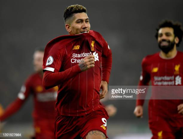 Roberto Firmino of Liverpool celebrates after scoring the second goal making the score 1-2 during the Premier League match between Wolverhampton...