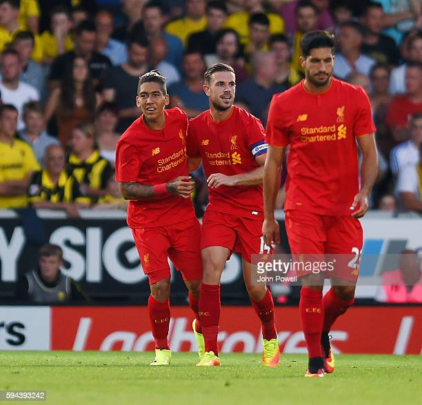 Roberto Firmino of Liverpool celebrates after scoring the second goal for Liverpool during the EFL Cup match between Burton Albion and Liverpool at...