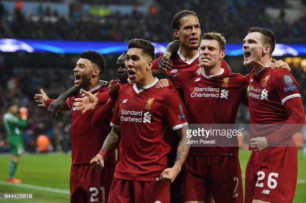 Roberto Firmino of Liverpool celebrates after scoring the second goal during the UEFA Champions League Quarter Final Second Leg match between...