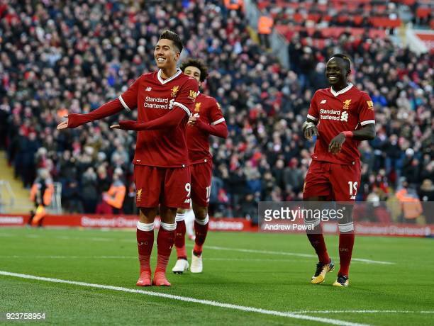 Roberto Firmino of Liverpool celebrates after scoring the third goal during the Premier League match between Liverpool and West Ham United at Anfield...