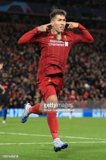 Roberto Firmino of Liverpool celebrates after scoring their 2nd goal during the UEFA Champions League round of 16 second leg match between Liverpool...